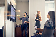 Employees of Quorum and Whitlock use the Microsoft Surface Hub for video conferencing and presentations in at Quorum's offices in Houston, TX on Wednesday January 11, 2107.<br /> <br /> Photographed by Houston,TX advertising photographer Nathan Lindstrom<br /> ©2017 Nathan Lindstrom