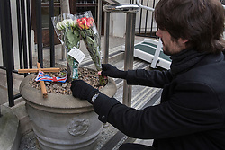 © licensed to London News Pictures. London, UK 13/12/2012. A man looking at the flowers which left outside King Edward VII hospital for Jacintha Saldanha, the nurse who apparently took her own life after being duped by two Australian DJ hoax callers. Photo credit: Tolga Akmen/LNP