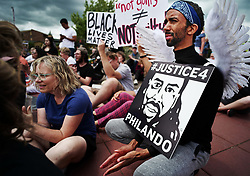 June 18, 2017 - St. Anthony, MN, USA - Protesters gather on Sunday, June 18, 2017 at Silver Lake Village Shopping Center in St. Anthony, Minn. for a memorial rally in honor of Philando Castile. Abdi Iman, of Eden Prairie, was dressed as an angel. ''Philando is looking down as an angel,'' he said. ''He should be here on Father's Day. (Credit Image: © Richard Tsong-Taatarii/TNS via ZUMA Wire)
