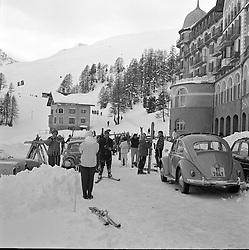 Skiers outside the Chantarella Hotel,  St.Moritz, Switzerland in February 1960.