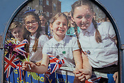 Summer scenes in a cracked window of the Age Concern charity, showing an event in the London suburb of Swanley in which Winter Olympic Skeleton medallist Lizzie Yarnold paraded her medal around Kent towns in 2018, on 3rd February 2020, in London, England.