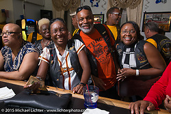 Terri Collins at the bar during the club meetup with the Flying Eagles MCat the American Legion in Catonsville, MD, USA. August 16, 2015.  Photography ©2015 Michael Lichter.
