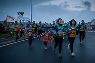 """People run on the 20th Korrika. Bidarte (Basque Country) April 2, 2017. The """"Korrika"""" is a relay course, with a wooden baton that passes from hand to hand without interruption, organised every two years in a bid to promote the basque language. The Korrika runs over 11 days and 10 nights, crossing many Basque villages and cities, totalling some 2300 kilometres. Some people consider it an honour to carry the baton with the symbol of the Basques, """"buying"""" kilometres to support Basque language teaching. (Gari Garaialde / Bostok Photo)"""