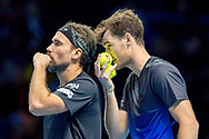 Jamie Murray of Great Britain whispers to his partner Bruno Soares of Brazil during the Nitto ATP World Tour Finals at the O2 Arena, London, United Kingdom on 13 November 2018.Photo by Martin Cole