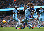 David Luiz of Chelsea clears the ball away from Aleksander Kolarov of Manchester City during the Premier League match at the Etihad Stadium, Manchester. Picture date: December 3rd, 2016. Pic Simon Bellis/Sportimage