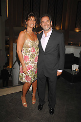 ZEEV GODIK Chief Executive of the Gaucho and his wife PATSY GODIK at the opening of the new Gaucho restaurant at the O2 Arena, London on 15th May 2008.<br />