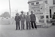 friends posing by a road sign in Bourg-Madame France Parc naturel regional des Pyrenees Catalanes