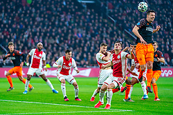 Dusan Tadic #10 of Ajax and Nick Viergever #4 of PSV Eindhoven in action during the match between Ajax and PSV at Johan Cruyff Arena on February 02, 2020 in Amsterdam, Netherlands