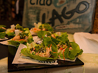 One of Lago's selections for the evening - shrimp lettuce cups - during the Winnipesaukee Wine Festival Thursday night at Church Landing in Meredith.  (Karen Bobotas/for the Laconia Daily Sun)