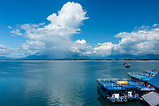 Photograph of floating restaurants on the shore Nam Ngum reservoir, in central Laos.