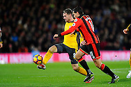 Aaron Ramsey (8) of Arsenal battles for possession with AFC Bournemouth midfielder Charlie Daniels during the Premier League match between Bournemouth and Arsenal at the Vitality Stadium, Bournemouth, England on 3 January 2017. Photo by Graham Hunt.