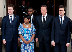 © London News Pictures. 22/04/2013. London, UK.  L to R - NICK CLEGG, DOREEN LAWRENCE, STUART LAWRENCE, DAVID CAMERON, ED MILIBAND pose for photographers outside St Martins in the Field Church in London following a memorial service to mark the 20 anniversary of the murder of Stephen Lawrence. Stephen Lawrence was murdered in a racist attack while waiting for a bus in SOuth London on the evening of 22 April 1993. Photo credit : Ben Cawthra/LNP