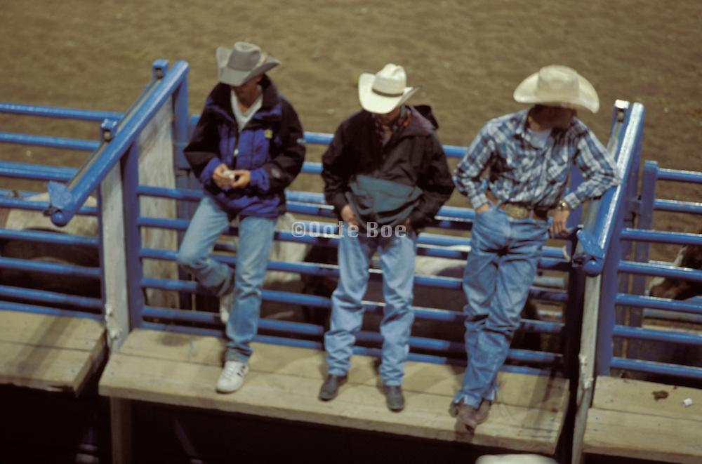 3 cowboys outside bull riding arena