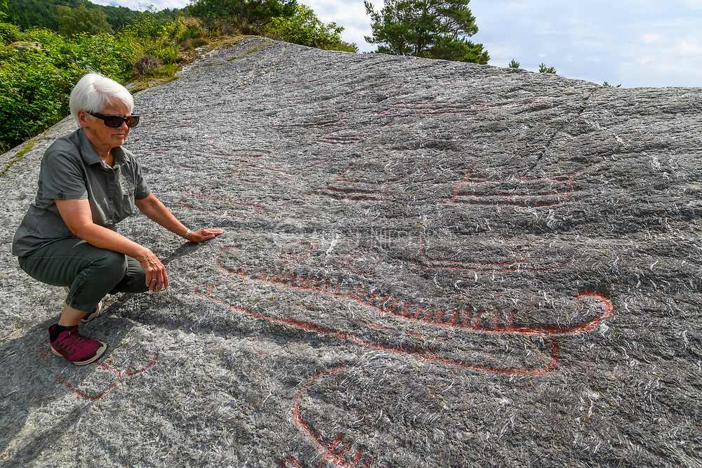 Observing rock carvings of ships and other objects at Solbakk (Strand, Rogaland, Norway) originating from the Nordic bronze age (1700-500 BC).
