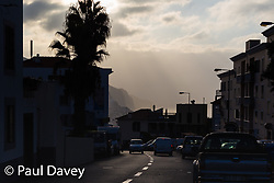 Hazy morning sunshine creates a graded series of silhouettes of distant cliffs in Funchal, Madeira (I only had a 50mm with me for this pic - a 200 would have allowed me to get just the cliffs and a little bit of foreground). MADEIRA, September 25 2018. © Paul Davey