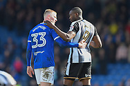 Chesterfield defender Alex Whitmore (33) and Notts County forward Shola Ameobi (9) during the EFL Sky Bet League 2 match between Chesterfield and Notts County at the b2net stadium, Chesterfield, England on 25 March 2018. Picture by Jon Hobley.
