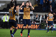 Per Mertesacker of Arsenal © holds up his hands as he congratulates teammate Hector Bellerin at end of match. Barclays Premier league match, Swansea city v Arsenal  at the Liberty Stadium in Swansea, South Wales  on Saturday 31st October 2015.<br /> pic by  Andrew Orchard, Andrew Orchard sports photography.
