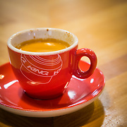 A Chris King made and branded cup and espresso in Portland, Oregon.