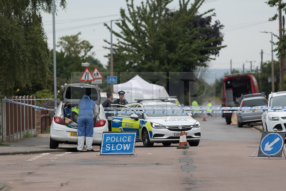 © Licensed to London News Pictures. 01/07/2017. GRAYS, Essex, UK.  A forensic officer arrives at the police cordon at Blackshots Lane in Grays, Essex. A man has died and three others have life threatening injuries following a street fight in Blackshots Lane, Grays, Essex last night.  Photo credit: Vickie Flores/LNP
