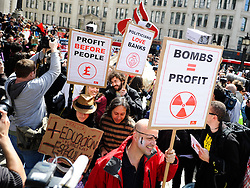 © Licensed to London News Pictures. 12/05/2012. London, Britain.  Occupy London protesters  posing in front of St. Paul's Cathedral. Photo credit : Thomas Campean/LNP