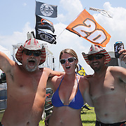 Chris Staley, Holly Martico and Doug Martico from Altoona, Florida party in their pool prior to the 57th Annual NASCAR Coke Zero 400 stock car race at Daytona International Speedway on Sunday, July 5, 2015 in Daytona Beach, Florida.  (AP Photo/Alex Menendez)
