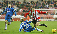 Photo. Andrew Unwin<br /> Sunderland v Wigan Athletic, Nationwide League Division One, Stadium of Light, Sunderland 02/12/2003.<br /> Sunderland's Julio Arca (r) dives over the challenge of Wigan's Jimmy Bullard (c).