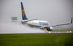 © Licensed to London News Pictures. 06/07/2021. Leeds UK. A Ryanair aircraft takes off from Leeds Bradford Airport this morning in heavy rain as the UK continues to be battered by storms. Photo credit: Andrew McCaren/LNP