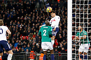 Tottenham Hotspur midfielder Dele Alli (20) wins a header during the Premier League match between Tottenham Hotspur and West Bromwich Albion at Wembley Stadium, London, England on 25 November 2017. Photo by Andy Walter.