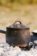 Breakfast cooked on the charcoal of a campfire, near Seronga in the Okavango Delta, Botswana