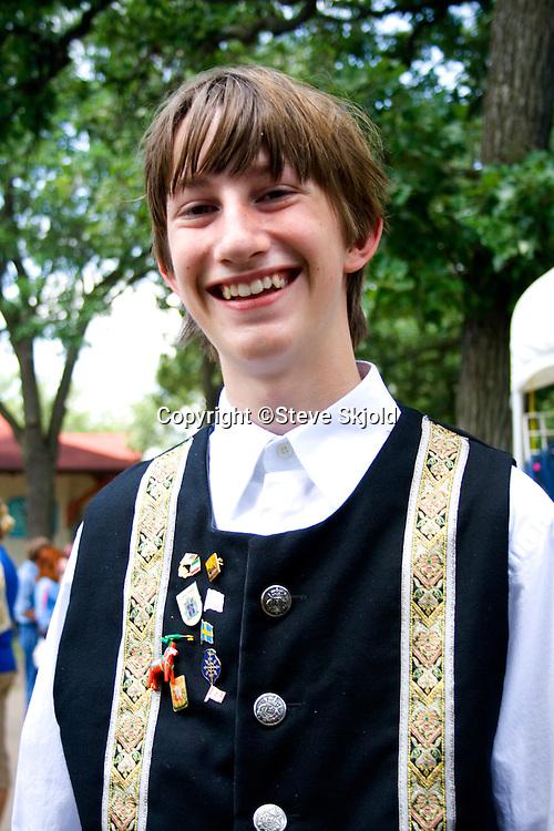 Happy teen age 16 wearing traditional outfit. Svenskarnas Dag Swedish Heritage Day Minnehaha Park Minneapolis Minnesota USA