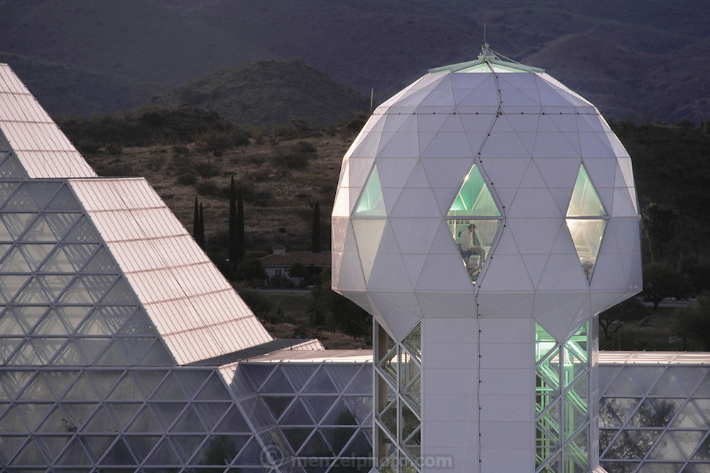 Biosphere 2 prototype space colony with living quarters with Mark Van Thillo in the library at dawn. The Biosphere was a privately funded experiment, designed to investigate the way in which humans interact with a small self-sufficient ecological environment, and to look at possibilities for future planetary colonization. 1992