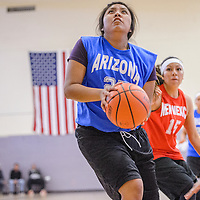 040314       Cable Hoover<br /> <br /> Arizona's Shayla Yellowman (25) charges through the New Mexico defense during the Arizona New Mexico Allstars match at Miyamura High School Thursday.