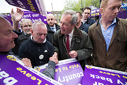 © Licensed to London News Pictures . 25/05/2016 . Bolton , UK . NIGEL FARAGE signs placards for supporters . The UKIP referendum bus tour , campaigning for a UK Brexit , lead by Nigel Farage , in Victoria Square , Bolton . Photo credit : Joel Goodman/LNP