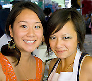 Two happy beautiful Hmong restaurant workers. Hmong Sports Festival McMurray Field St Paul Minnesota USA