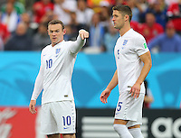 Wayne Rooney of England and Gary Cahill of England