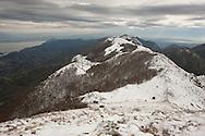 Rumija, a mountain above Lake Skadar (visible on the left) and Stari Bar, after October snowfall, Montenegro. Looking towards Albania. © Rudolf Abraham
