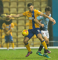 Andy Taylor of Blackpool battles with Patrick Hoban of Mansfield Town<br /> <br /> Photographer James Williamson/CameraSport<br /> <br /> The EFL Sky Bet League Two - Mansfield Town v Blackpool - Tuesday 22nd November 2016 - One Call Stadium - Mansfield<br /> <br /> World Copyright © 2016 CameraSport. All rights reserved. 43 Linden Ave. Countesthorpe. Leicester. England. LE8 5PG - Tel: +44 (0) 116 277 4147 - admin@camerasport.com - www.camerasport.com