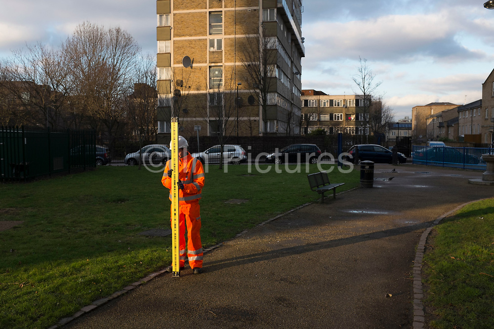 Surveyor holding a prism pole or ranging pole. Surveying or land surveying is the technique, profession, and science of accurately determining the terrestrial or three-dimensional position of points and the distances and angles between them, commonly practiced by surveyors, and members of various engineering professions.