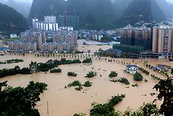 Aug. 14, 2017 - Rongshui, Liuzhou, China - Parts of downtown Rongshui County are flooded in Rongshui Miao Autonomous County, south China's Guangxi Zhuang Autonomous Region.  Torrential rain has swept parts of Guangxi lately.  (Credit Image: © Liao Ziyuan/Xinhua via ZUMA Wire)