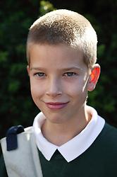 Portrait of boy in school uniform,
