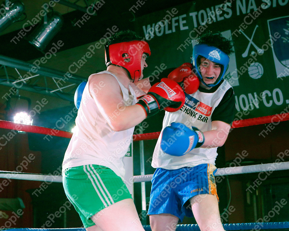 """16/03/2014<br /> Ian """"Mulerlicious"""" Mulcahy of Newmarket on Fergus GAA and Stephen """"Twinkle Toes"""" McInerney of Wolfe Tones GAA, Shannon in action at the White Collar Boxing tournament at the Oakwood Arms Hotel, Shannon. <br /> Picture: Don Moloney / Press 22"""