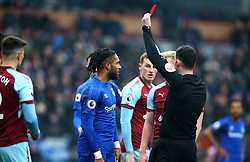 Everton's Ashley Williams (centre) receives a red card from Referee Chris Kavanagh during the Premier League match at Turf Moor, Burnley.