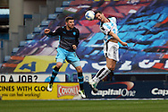 Gary Hooper of Sheffield Wednesday (l) and Mark Hudson of Huddersfield Town jump for the ball. Skybet football league Championship match, Huddersfield Town v Sheffield Wednesday at the John Smith's Stadium in Huddersfield, Yorkshire on Saturday 2nd April 2016.<br /> pic by Chris Stading, Andrew Orchard sports photography.