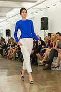 White pants with electric blue long-sleeved top. By Carmen Marc Valvo at the Spring 2013 Fashion Week show in New York.