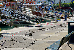 July 21, 2017 - Kos Island, Greece - The broken quay wall is raised by several inches in the harbor after an earthquake in Kos on the island of Kos. Greek authorities said two tourists killed in the overnight quake are from Turkey and Sweden (Credit Image: © Eurokinissi via ZUMA Wire)