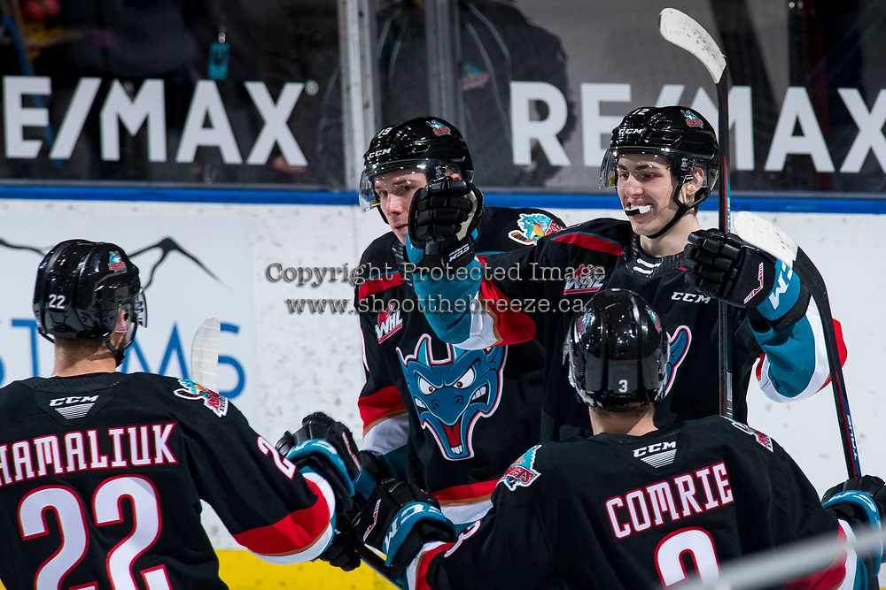 KELOWNA, BC - MARCH 26: Forward Steel Quiring #12 of the Kelowna Rockets first bumps teammates to celebrate his first WHL goal during first period against the Victoria Royals at Prospera Place on March 26, 2021 in Kelowna, Canada. (Photo by Marissa Baecker/Shoot the Breeze)
