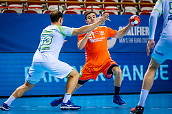 The Dutch handball player Kay Smits in action against Darko Cingesar from Slovenia during the European Championship qualifying match on January 6, 2020 in Topsportcentrum Almere