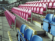 Dulwich Hamlet FC team colour stadium seating, pink and blue, on the 26th January 2019 at Champion Hill in South London in the United Kingdom.
