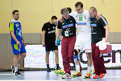 Gergely Harsanyi #10 of Hungary injured during handball match between National teams of Slovenia and Hungary in play off of 2015 Men's World Championship Qualifications on June 15, 2014 in Rdeca dvorana, Velenje, Slovenia. Photo by Urban Urbanc / Sportida