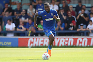 AFC Wimbledon defender Deji Oshilaja (4) dribbling during the Pre-Season Friendly match between AFC Wimbledon and Queens Park Rangers at the Cherry Red Records Stadium, Kingston, England on 14 July 2018. Picture by Matthew Redman.